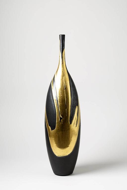 Set Of Ceramic Bottles With Gold And Black Glaze
