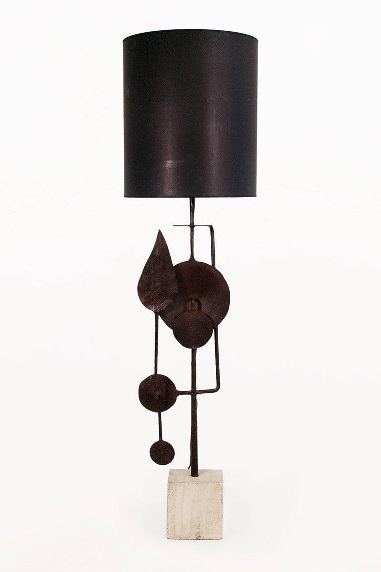 Very large sculptural table lamp by Giovanni Banci Forged iron sculptural structure with rectangular travertine base, circa 1970, Italy Very good vintage condition.