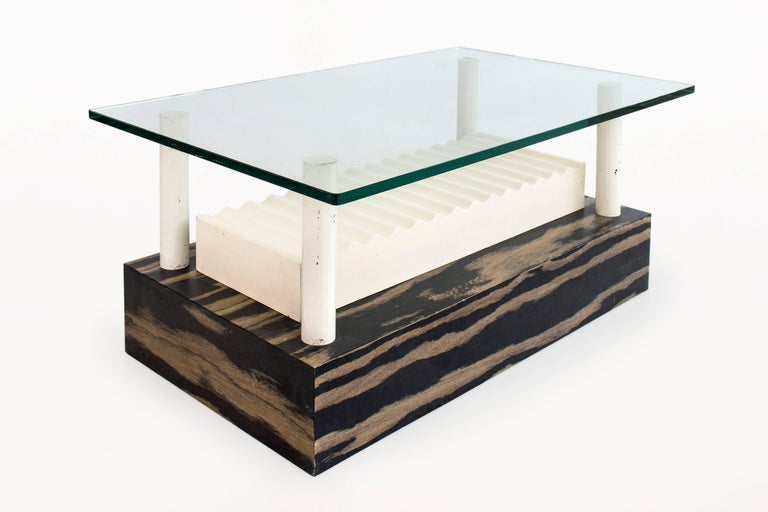 Memphis Milano coffee table by Ettore Sottsass for Alessi unique, one-of-a-kind Designed by Sottsass for Alessi glass top suspended by 4 lacquered metal columns positioned in a laminated wooden base with figurative wave center piece Provenance: