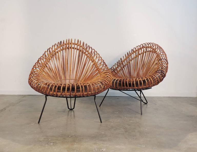 Splendid pair of Rattan armchairs attributed to Franco Albini. At the moment there is no official documentation regarding the designer. These were manufactured in Italy and sold through La Rinascente.