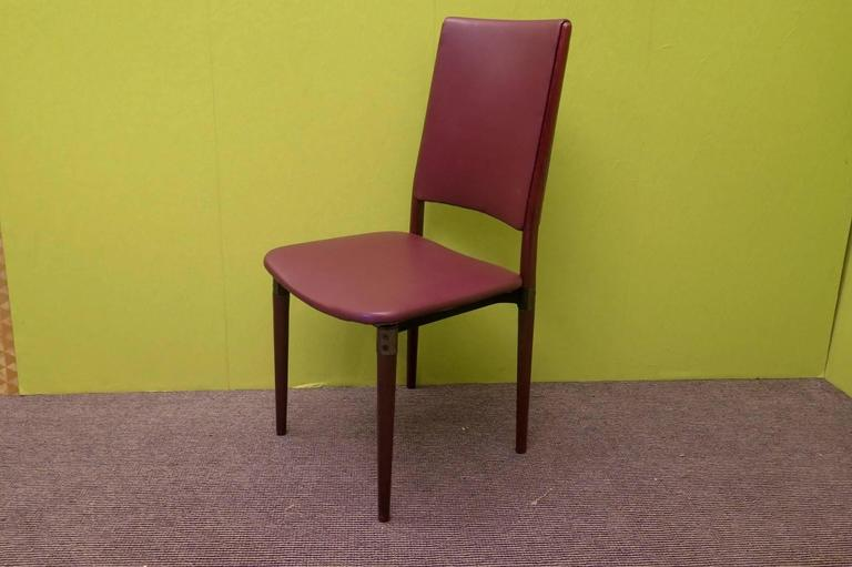 Six Osvaldo Borsani punched Chairs from 1960. All covered in red leather ( the leather is original of the years), with wooden legs, and metal frame. Founder with his brother Fulgenzio of Tecno, architect Osvaldo Borsani has given life to