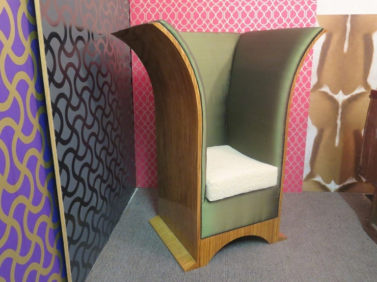 Two comfortable and enveloping thrones. Extraordinary design for this pair of art deco armchairs.  All veneered in citronè wood, with green silk upholstery and white velvet cushion. Very special its design with a simple seat but two huge side