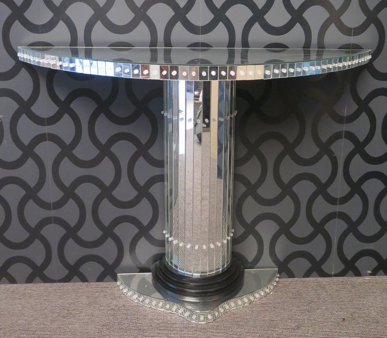 Murano Art Deco console of 1940s.  All covered in mirror. The shape of the top is in demilune shape, and above it is placed a mirror of the same shape. The small band of the top is composed of small mirror inserts held up by nails with a small head
