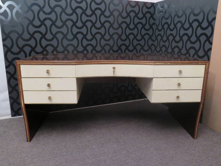 Italian Art Deco writing desk, embellished with particular materials, walnut wood, goatskin and brass.
