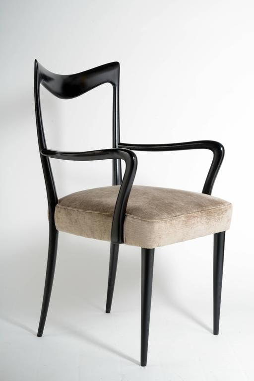 Solid sculptured wood black lacquered and elegant shaped, beige new velvet seat upholstered.