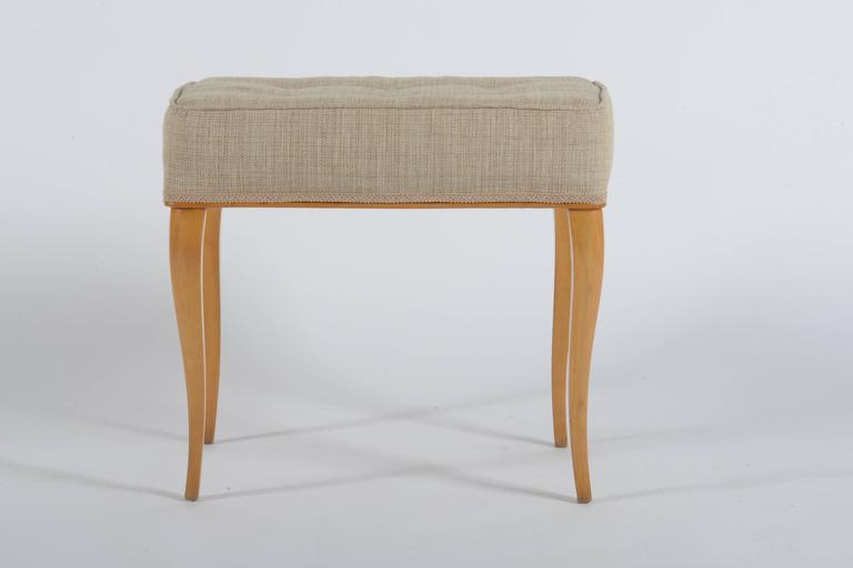 Solid maples curved leggs and structure, newly upholstered with beige cotton fabric.