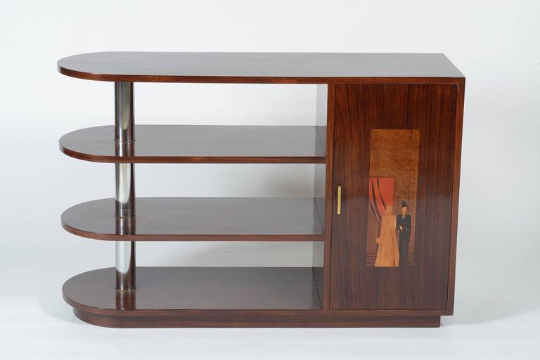 Rationalist center piece of furniture cabinet bar, book case, serving table finished in all the side in exotic wood , two doors inlaid (all kind of different wood )with 'courtship serenade' one side and 'wedding' in the other side, two stylized and