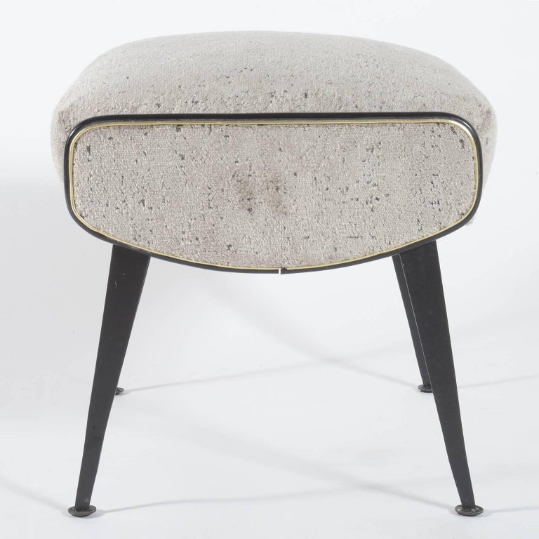 Pair of Italian, 1950s stools with slender black metal legs. The seats are newly covered with velvet fabric keeping the original trimmings details in black and silver.