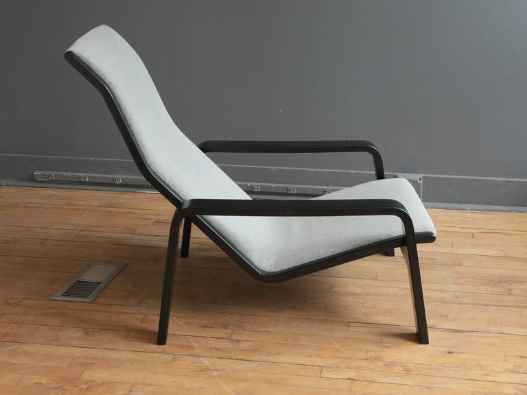 An adjustable lounge chair designed by Tapio Wirkkala for Stending, circa 1960s or 1970s. Features an ebonized ash frame with upholstered grey sling. 