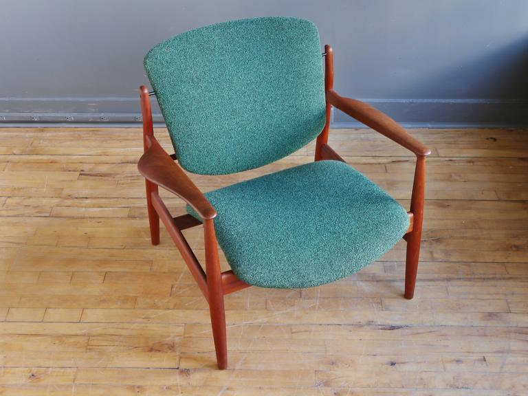"A ""Model FD 136"" lounge chair designed by Finn Juhl and manufactured by France & Son, circa 1958. Featuring a sculptural teak frame and original green wool upholstery. 