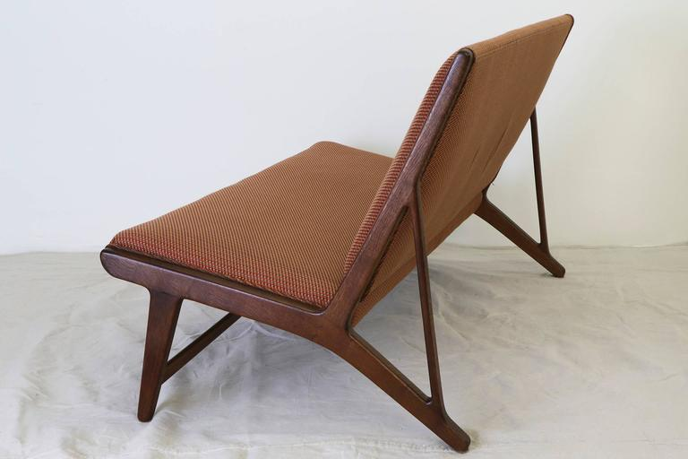 "A rare ""Model JH555"" settee designed by Hans Wegner for Johannes Hansen, circa 1950. Featuring a solid oak frame with upholstered seat and back. 