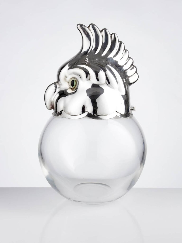 Novelty Art Deco ice bucket in the form of a Parakeet, Austria, circa 1930.   This is a very unusual subject and well made not only the lid but also the plated lower rim section where when closing the lid it gives a cushion effect.