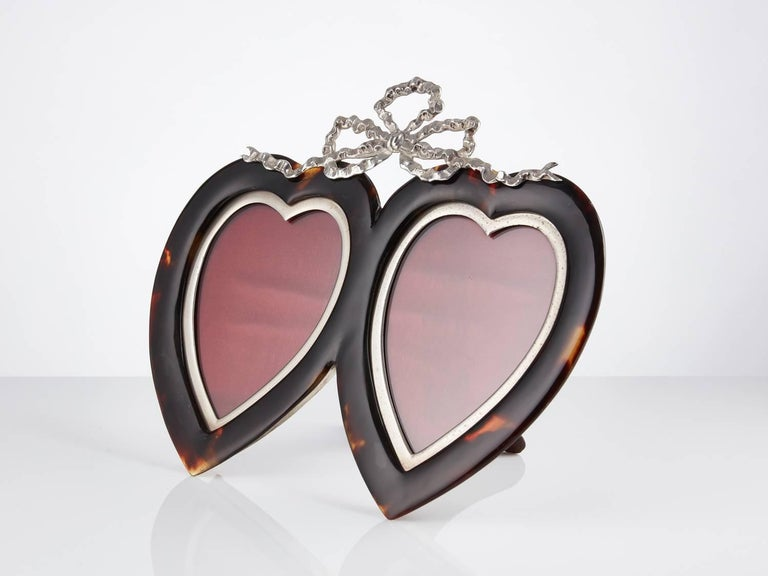 Tortoiseshell and silver heart photograph frame date London, 1897 Maker Henry John Batson & Albert Edward Batson  This frame is in excellent condition the tortoiseshell retains its original patina, the cast silver surround and bow decoration set