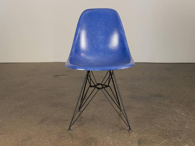 Original 1960s molded fiberglass shell chairs in Ultramarine Blue, designed by Charles and Ray Eames for Herman Miller. Gleaming shells are in original condition, each with a distinct thready texture.  Shown here mounted on new black Eiffel base,