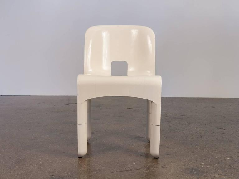 Pre-production model of Joe Colombo's iconic 1967 Sedia Universale in white injection-molded ABS plastic. Intended to serve many purposes, the chair's legs are removable and can be swapped for different heights.  This is a test series model that
