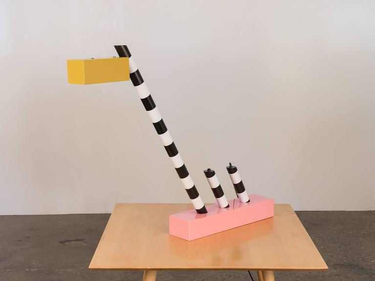 A playful and provocative table lamp designed in 1981 by Michele De Lucchi, a cofounder of the Memphis movement. The Oceanic Lamp is a signature design that incorporates an anthropomorphic form and bold colors and pattern into a piece that functions