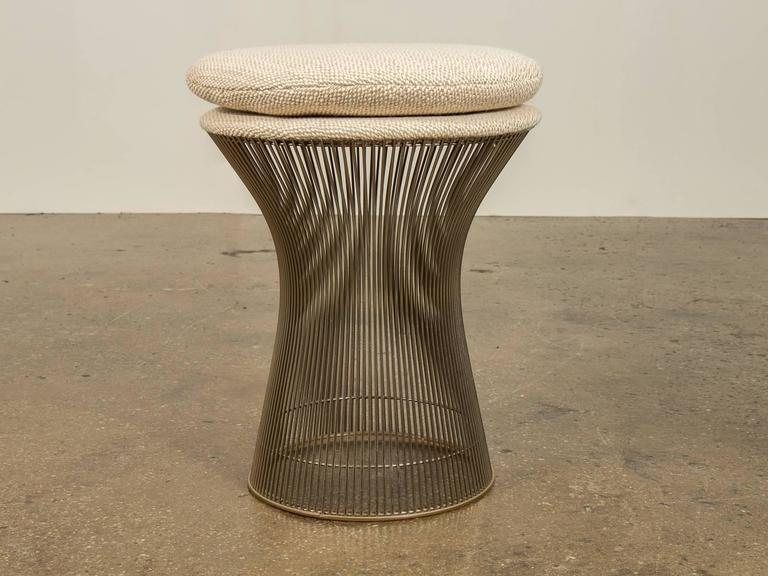 Industrial and organic steel wire stool by Warren Platner from the Platner Collection for Knoll, 1966. Newly upholstered in a creamy, textural wool, 1960s. In excellent condition. Currently in stock and can ship out in 2-3 days.  Measures: 17.5