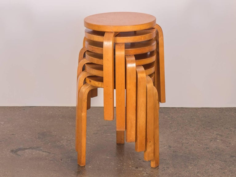 Classic set of six vintage Alvar Aalto Model 60 stacking stools for Finsven. Originally designed in 1932, our group are lovely, early examples of the model 60 design. The iconic stool features the L-shaped, steam bent legs which stack conveniently