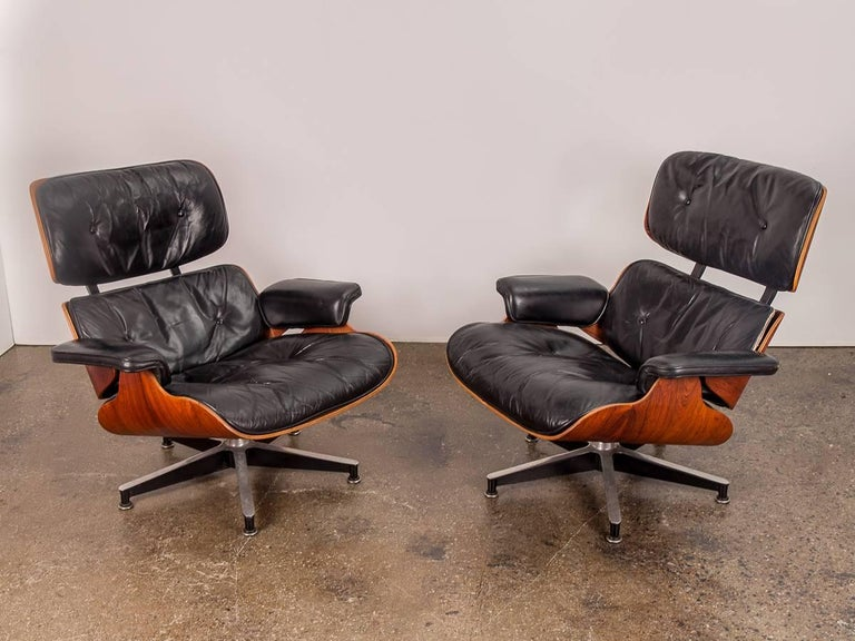 Newly acquired from the original owner, a pair of early 1960s, second generation Eames 670 Lounge Chairs and matching 671 Ottomans. Both retain their original leather that is in amazing condition—lovingly worn and comfortably plush, with a nicely