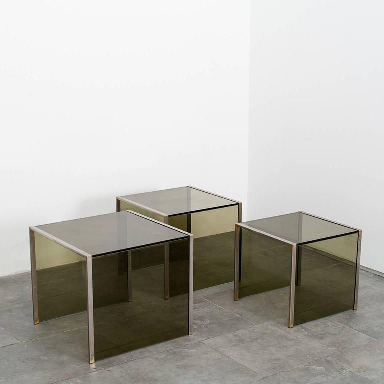 Set of three smoked glass nest side tables.