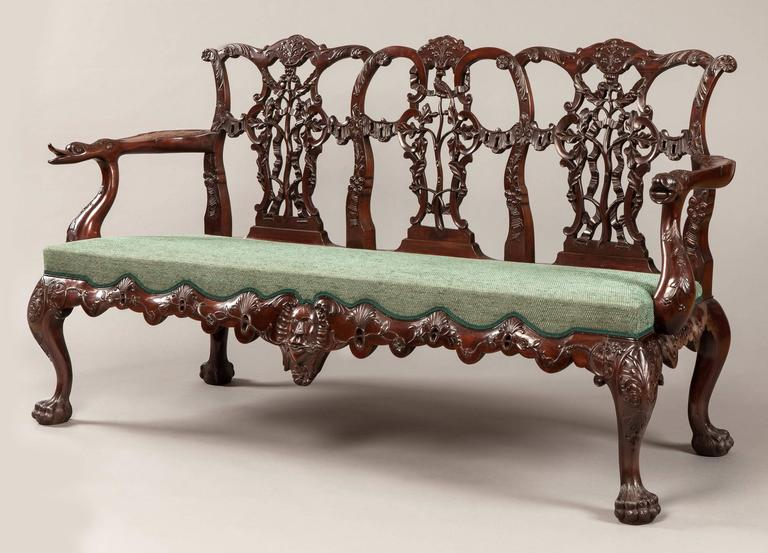A pair of triple back settees In the mid-Georgian Chippendale manner