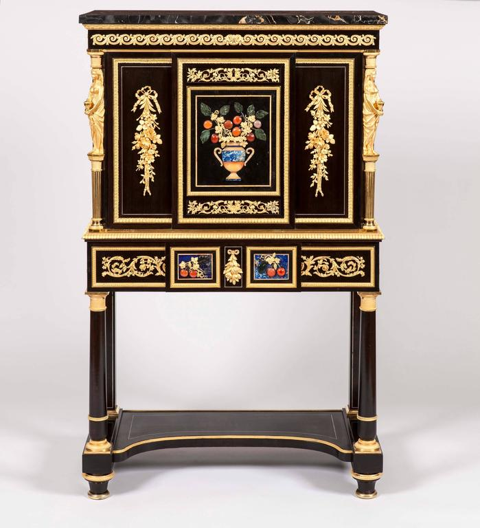 A fine pair of secrétaires à Abattant Attributed to Alexandre-Louis Bellangé  Constructed in ebony, and dressed with two-color gold ormolu mounts, made with exceptional refinement, Florentine Pietra Dura panels (with colors of blue, red, orange and