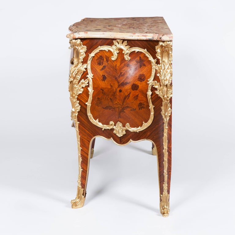 A fine commode in the Louis XV manner after a model by Jacques Dubois By Maison Rogié of Paris.