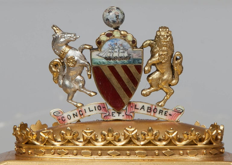 An Elkington & Company Silver Gilt Presentation Casket Hall Marked for Birmingham, 1891 and the maker; the casket, in the Victorian Gothic manner, with cluster columns at the angles, with fascias of lancet arches dressed with trefoils, and has a