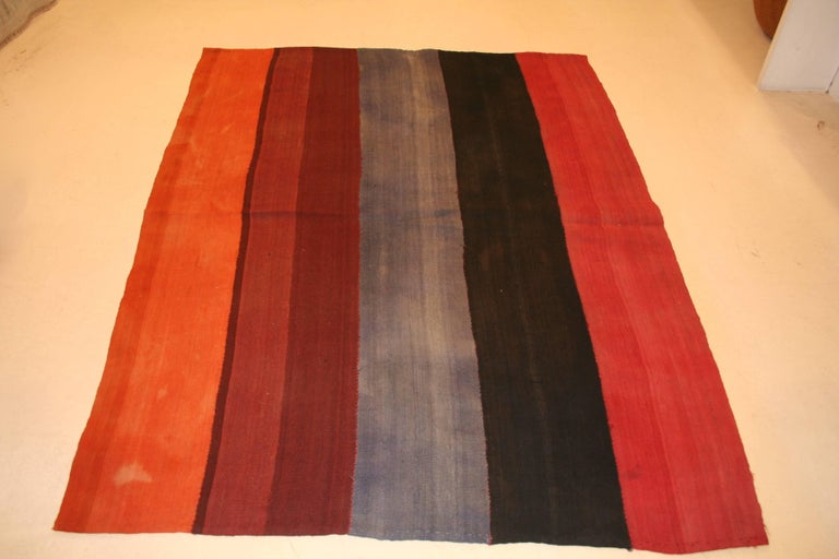 Woven in five vibrant colors, this Turkish wool flat-weave was used by Kurdish nomadic tribes located around the area of Sivas as a tent divider, hanging from the ceiling of the tent creating a partition. Called 'perdeh', which means curtain in