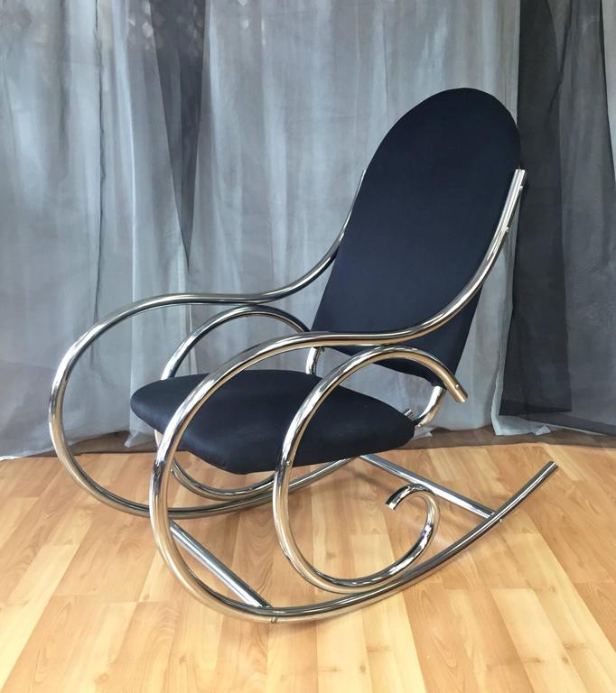 A Generously Sized Upholstered Chrome Rocker In The Style Of The Iconic  Bentwood Creations Of Thonet