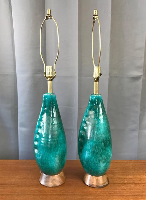 A pair of Mid-Century turquoise ceramic table lamps with wood bases by Marcello Fantoni.