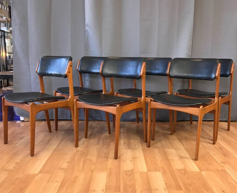 A six piece set of classic Danish OD 49 teak and leather dining chairs