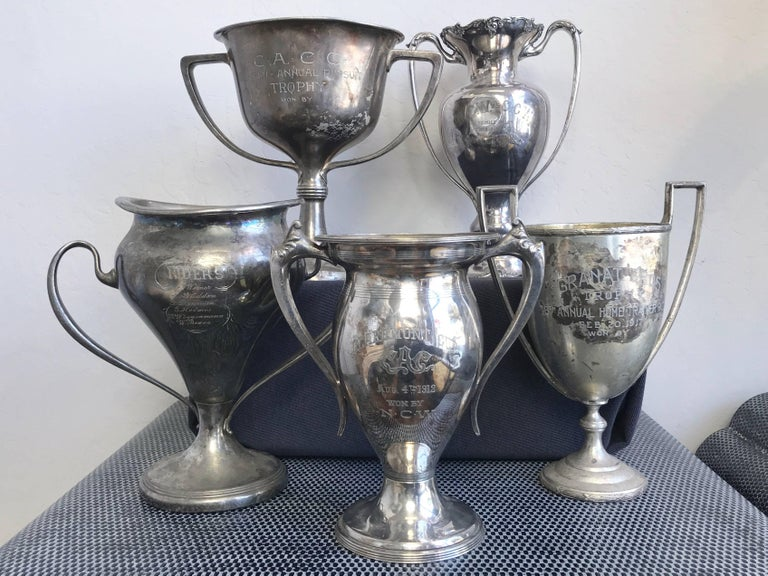 An historically important grouping of five Bay Area, California, silverplate cycling club trophies dating from 1908 to 1917.  A handsome collection of bicycle racing memorabilia, and a testament to San Francisco's and its nearby cities' indomitable