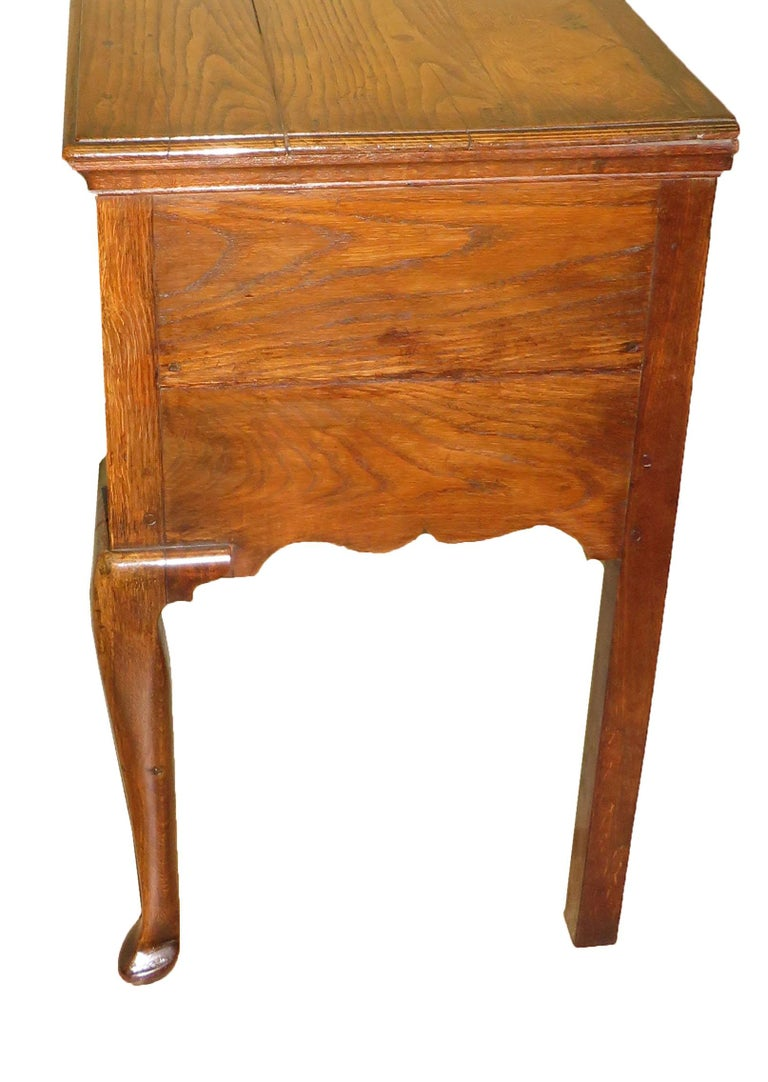 An attractive George III period oak dresser base having