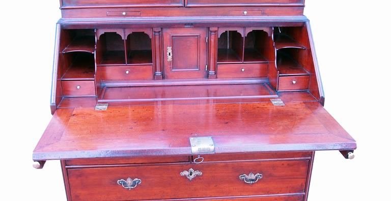 A delightful early 18th century solid walnut bureau bookcase having attractive double domed top with replacement mirror plates to panelled doors enclosing well fitted interior above well figured fall, two short and two long drawers with