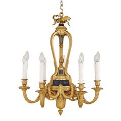 French Belle Époque style gold ormolu and blue detail nine light chandelier