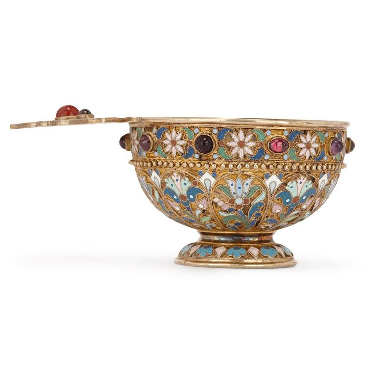 Crafted with the highest quality craftsmanship, this charka was used as a drinking vessel in Russia. The charka is of typical circular form with a small handle, of silver gilt mounted with cabochon amethysts and garnets and set on a circular foot,