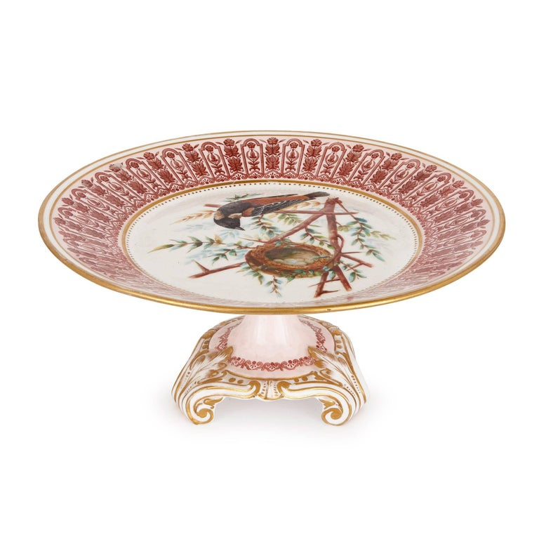 This splendid antique dessert service is impressive both for its beautiful design and its prestigious maker, Royal Crown Derby Porcelain, which was appointed the official royal porcelain manufacturer to Queen Victoria of England in 1890.