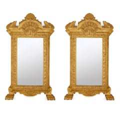 Pair of Large French Carved Giltwood Mirrors in the Empire Style