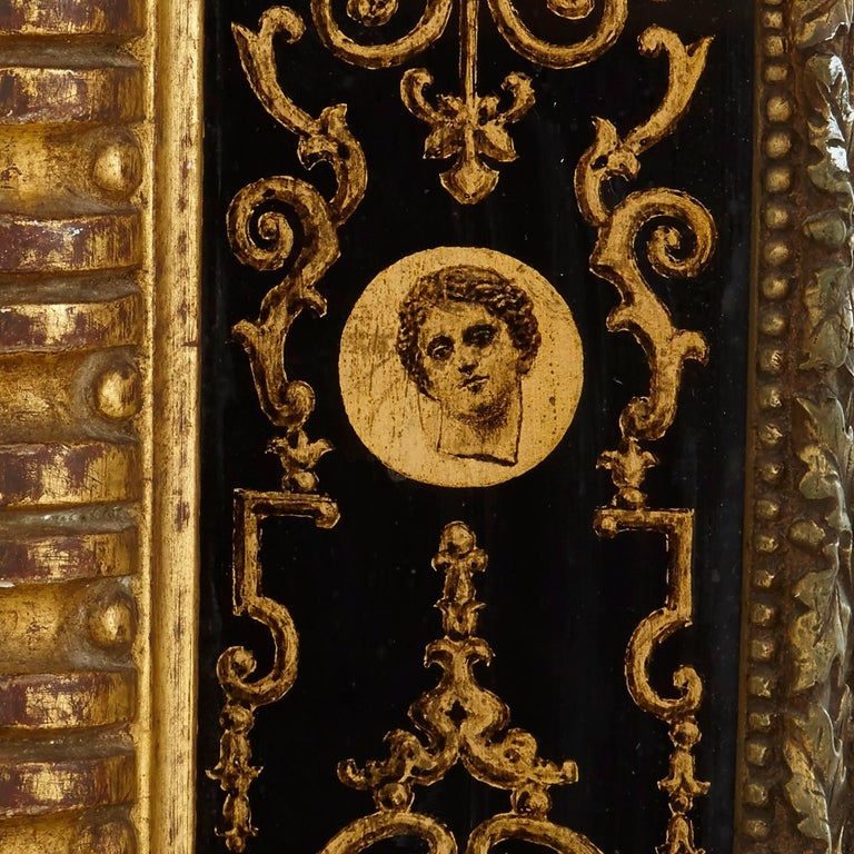 The frame of this fine, Italian, antique giltwood mirror references a style that was often used in designs for marquetry that was popular late in the reign of Louis XIV and pioneered by marqueteur Andre-Charles Boulle. However, here the effect is