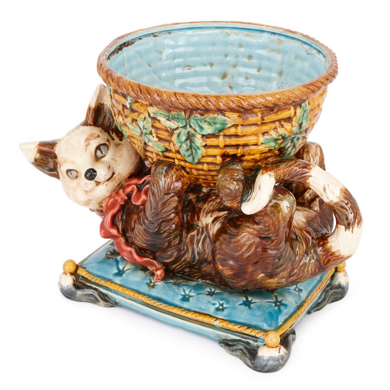 This charming and playful model is crafted in Majolica by Jerome Massier, who, together with his cousins, revived the production of Majolica-ware in the French town Vallauris in the late 19th century. The Massiers became known for their playful