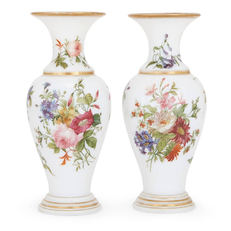 These exquisite 19th century French vases have been attributed to the famed French glass manufacturer Baccarat, the maker of some of the finest pieces of glassware in history. The vases take an ovoid shape, and their bodies are crafted from smooth