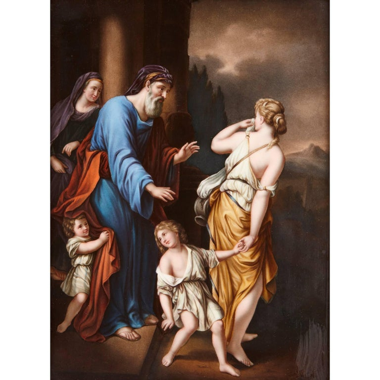 This fine KPM porcelain plaque depicts the biblical story of the expulsion of Hagar by Abraham. Abraham is shown bearded in a blue robe, as he casts away his mistress Hagar and her son Ishmael upon the instruction of his wife Sarah. Sarah watches on