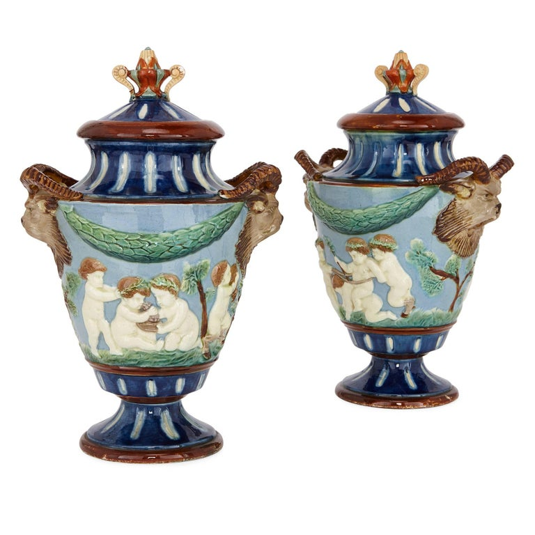 Pair of antique vases with putti