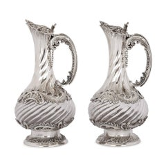 Pair of French Rococo Style Silver and Crystal Jugs