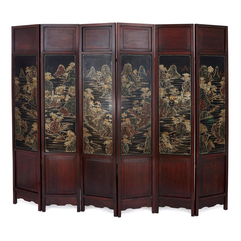Dedicated craftsmanship in traditional techniques, combined with refined simplicity in design, makes this antique Chinese screen a truly special piece. Built from hardwood and decorated with lacquer, hardstones, enamels, and paint, the screen is a