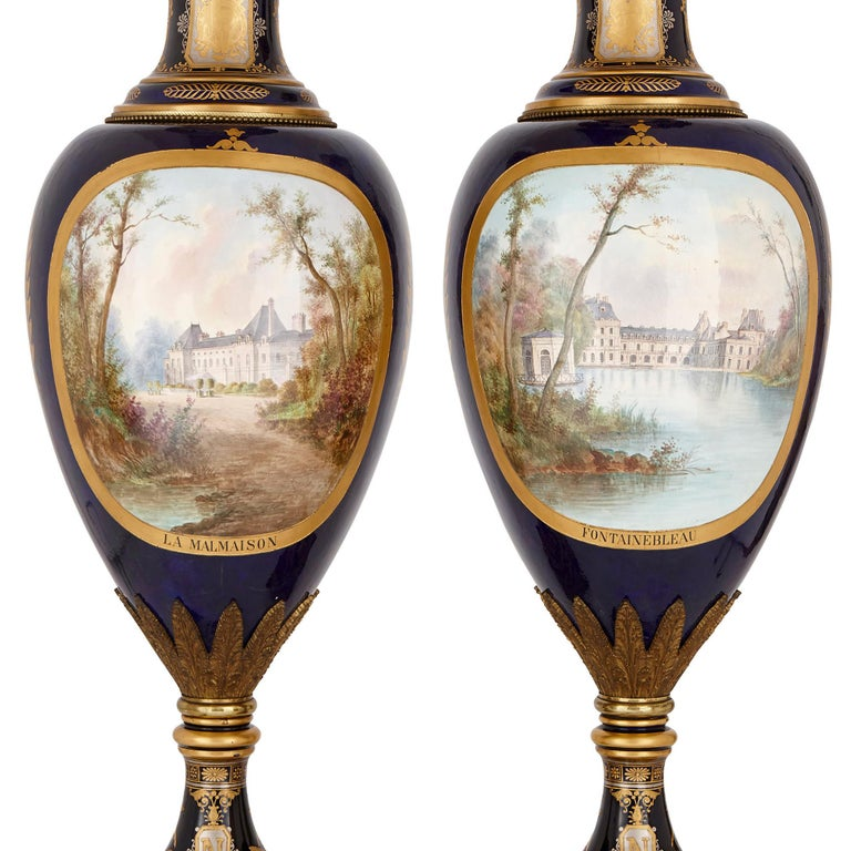 Empire Two Large Sèvres Style Gilt Bronze Mounted Porcelain Vases on Walnut Plinths For Sale