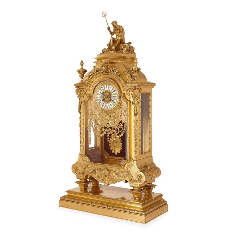 Made by Ferdinand Barbedienne (French, 1810-1892), the design by Louis-Constant Sevin (French, 1821-1888).  The central circular dial signed 'F. Barbedienne' and 'A Paris' in an architectural glass clock case applied with masks and trailing foliage