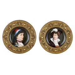 Pair of framed antique circular porcelain portrait plaques