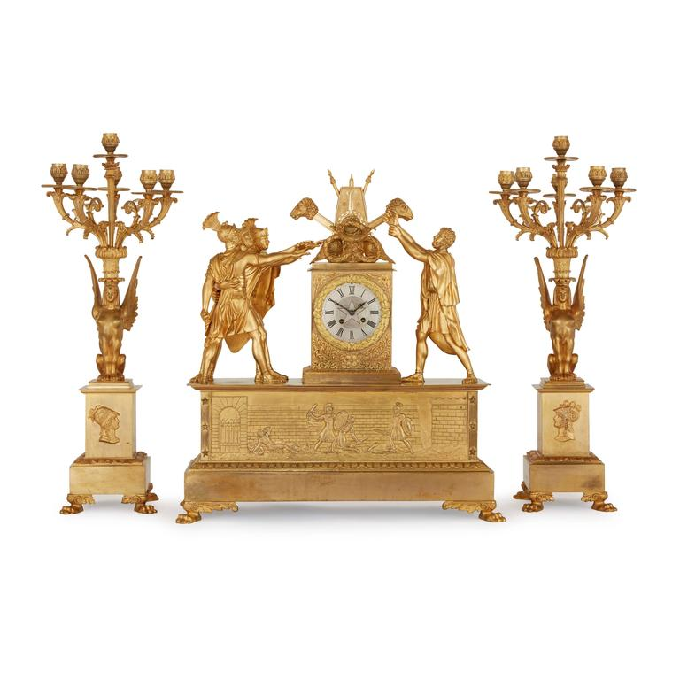 This exquisite 19th century trio is comprised of a central clock and a pair of flanking six-light candelabra.   The design of the clock case is widely acknowledged to be inspired by one of the most important paintings of French Revolution, 'The
